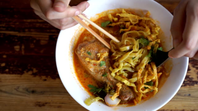 eating khao soi,  thai northern noodle - pickled stock videos and b-roll footage