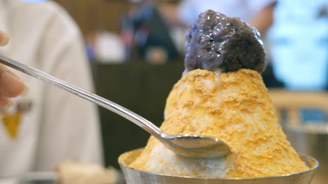 eating korean dessert - nut food stock videos & royalty-free footage