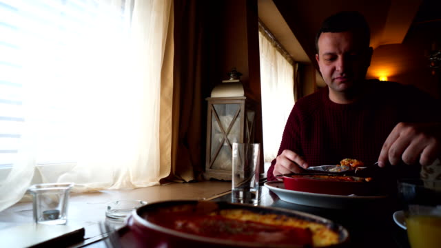 eating lasagna - lasagna stock videos & royalty-free footage