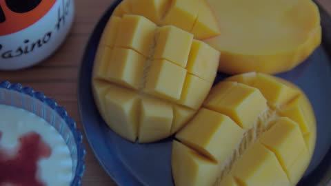 eating mango at breakfast. - mango fruit stock videos & royalty-free footage