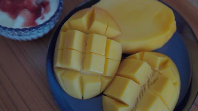 eating mango at breakfast.
