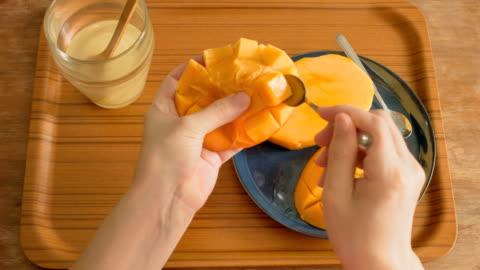 eating mango. - mango fruit stock videos & royalty-free footage