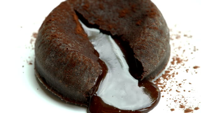 slo mo - eating molten chocolate cake - dolci video stock e b–roll
