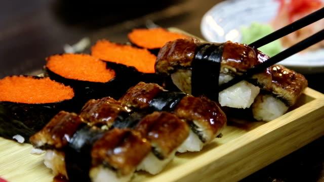 eating nigiri. - toro fish stock videos and b-roll footage