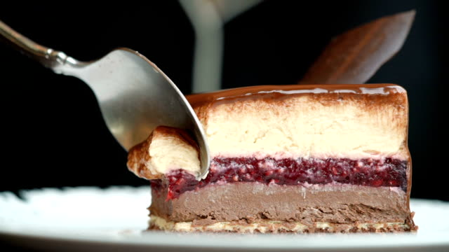 slo mo - eating opera cake with spoon - dessert stock videos & royalty-free footage