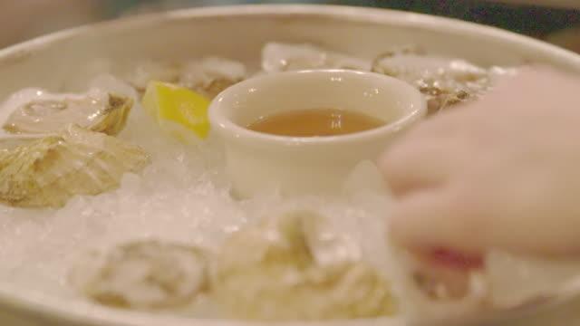 Eating oyster in restaurant