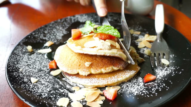 eating pancakes with maple syrup - brunch stock videos & royalty-free footage