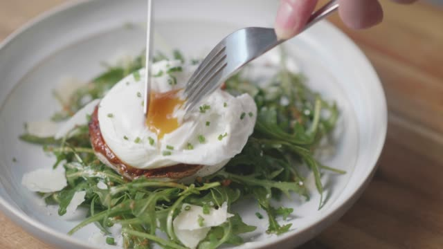 eating poached eggs on top of salad - wood plate stock videos & royalty-free footage