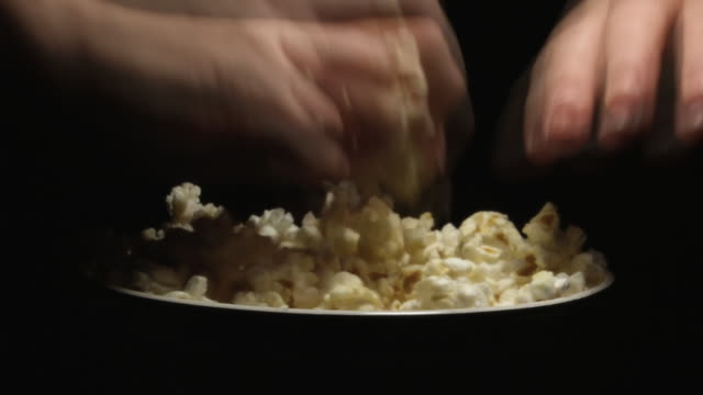 eating popcorn - popcorn stock videos & royalty-free footage