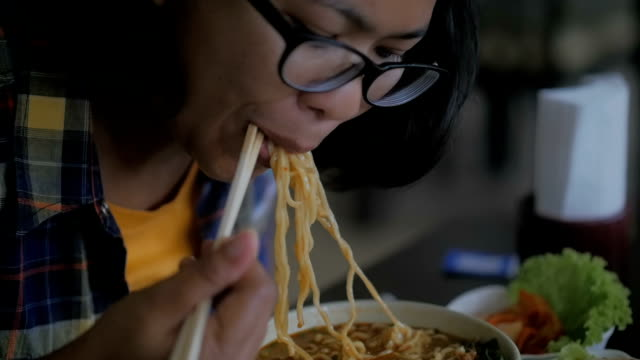eating ramen noodles, slow motion - ramen noodles stock videos & royalty-free footage