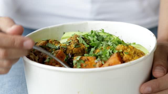 eating salad in bowl - lunch break stock videos & royalty-free footage