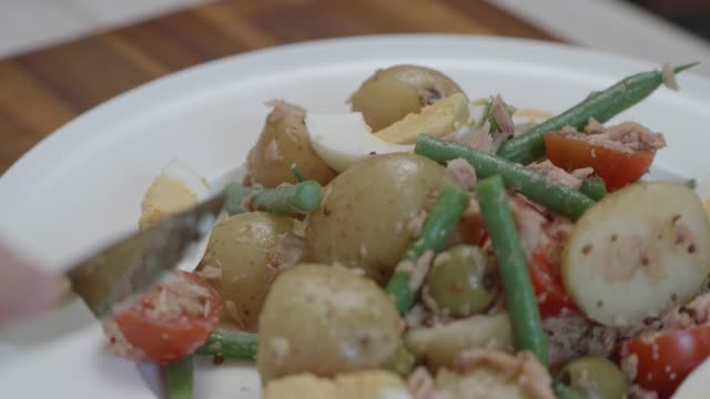 eating  salad nicoise - salad nicoise stock videos & royalty-free footage