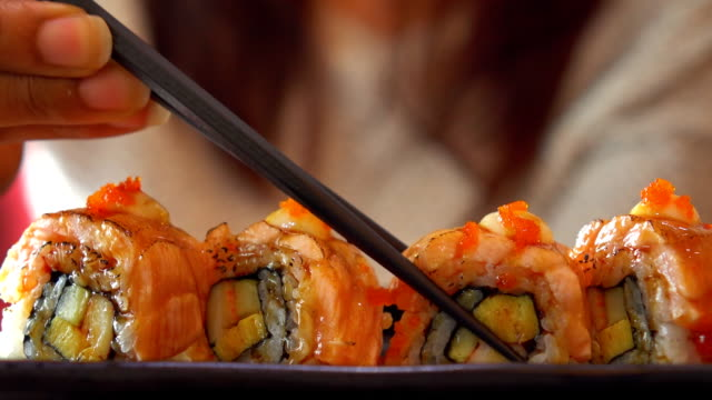 eating salmon roll - japanese food stock videos & royalty-free footage