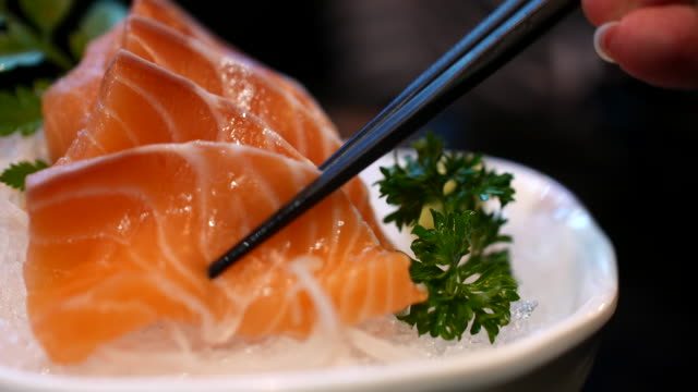Eating salmon sashimi, 4K(UHD)