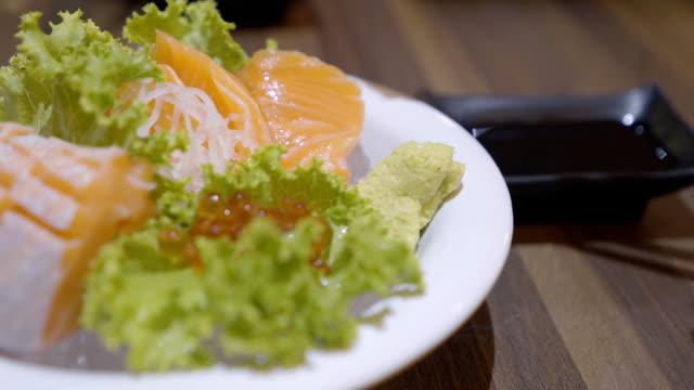 eating salmon sashimi