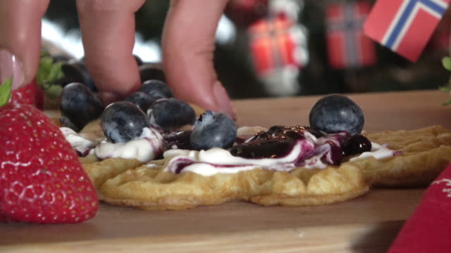 eating scandinavian waffles served with sour cream and jelly - traditionally norwegian stock videos & royalty-free footage