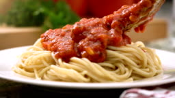 Eating spaghetti with tomato sauce Italian food