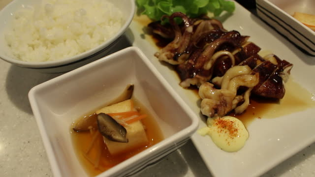 eating squid japanese food - brussels sprout stock videos & royalty-free footage