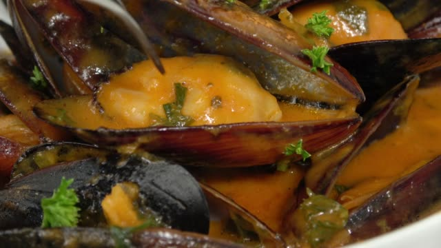 Eating Steamed PEI Mussels in Savory Tomato Garlic Sauce.