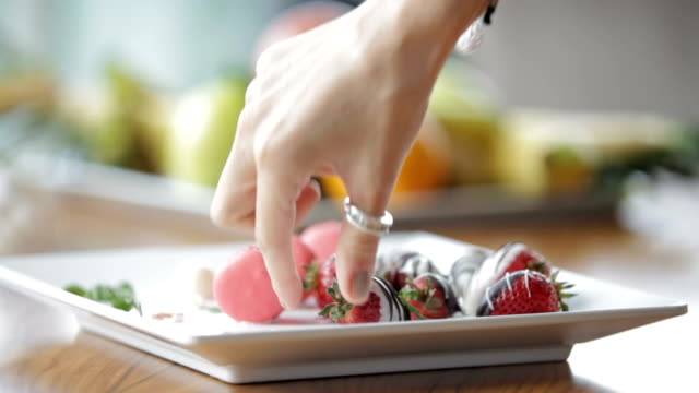 eating strawberries dessert - macaroon stock videos and b-roll footage