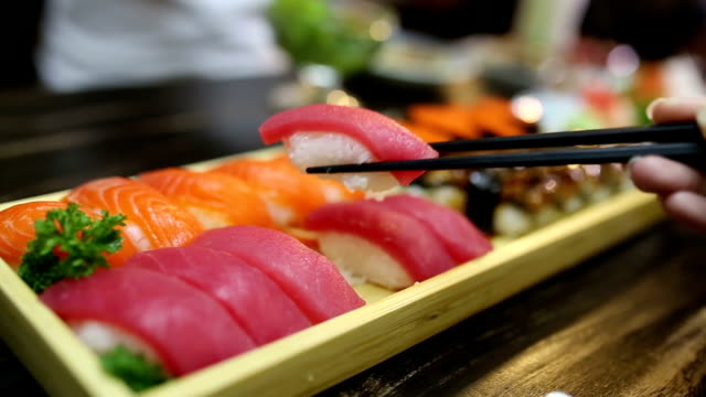 eating sushi. - toro fish stock videos and b-roll footage
