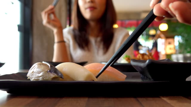 eating sushi pov - sushi video stock e b–roll