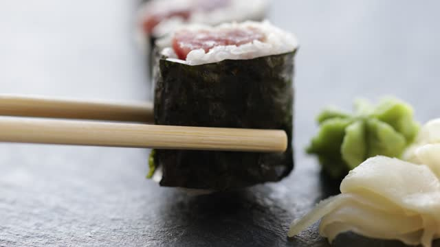 eating sushi with chopsticks - dining stock videos & royalty-free footage
