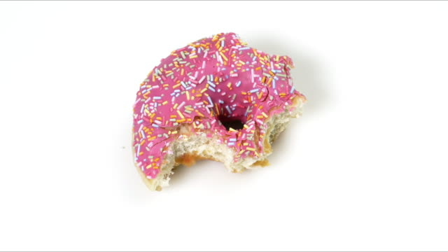 eating sweat pink doughnut - food stock videos & royalty-free footage