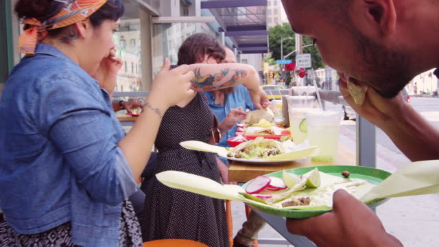 eating tacos outside downtown taqueria - pavement cafe stock videos & royalty-free footage