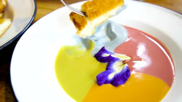 eating thai dessert, baked butter bread with egg custard (sang ka ya). - custard stock videos & royalty-free footage