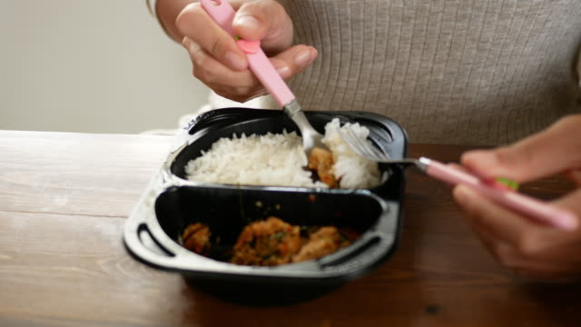 eating thai food lunch box - take away food stock videos and b-roll footage