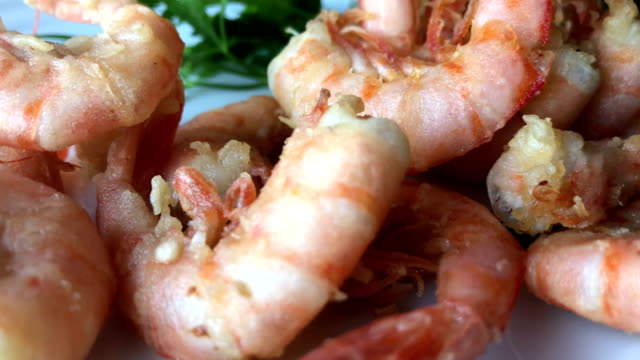 Eating tiger prawn shrimp by hand