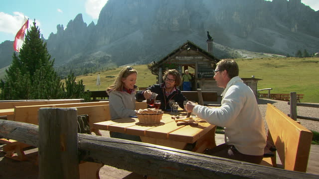 eating traditional food in the mountains - speck stock-videos und b-roll-filmmaterial