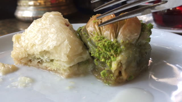 eating turkish baklava with pistachio, traditional dessert - sweet food stock videos & royalty-free footage