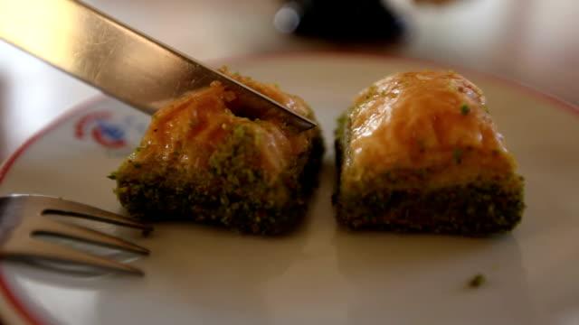 Eating Turkish dessert Baklava