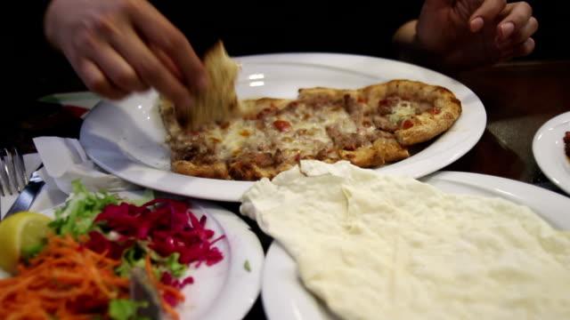 Eating Turkish pide
