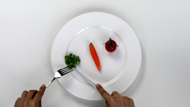 eating vegetable plate, green peas, tomato, carrot - forbidden stock videos & royalty-free footage