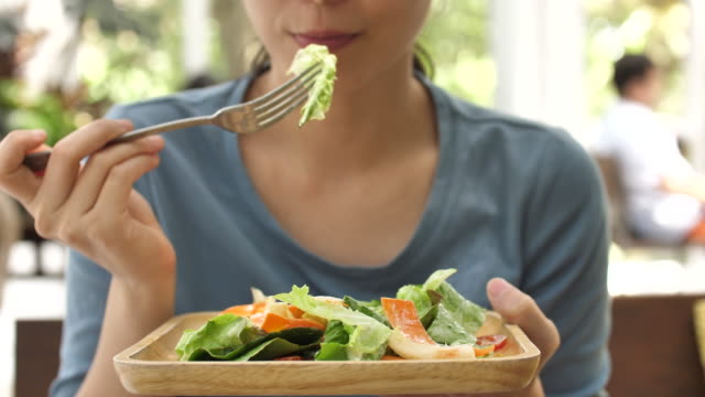 eating vegetable salad - eating stock videos & royalty-free footage