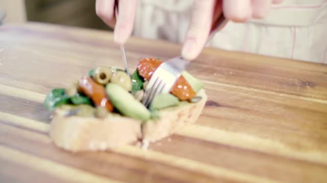 eating vegetarian bruschetta on wooden board