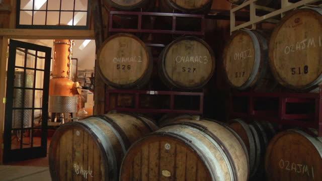 ws pan eau de vie barrels in winery / ashford, connecticut, usa - wine cask stock videos and b-roll footage