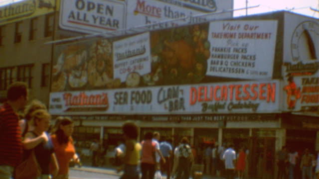 ebbets field apartments / brooklyn subway / brighton beach / kosher markets / rivoli theater on broadway showing jaws / bond clothes in times square... - coney island stock-videos und b-roll-filmmaterial