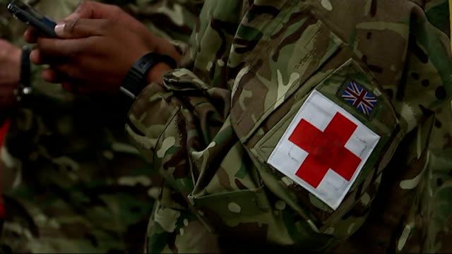 ebola crisis: british army medics prepare to leave for sierra leone; england: hampshire: aldershot: normandy barracks: ext / night **flashlight... - aldershot stock videos & royalty-free footage