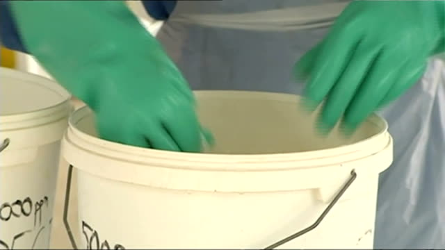 british military nurse with ebola flown back to uk from sierra leone; / t10111448 sierra leone: kenema: 'high risk area' sign at ebola treatment... - ラテックス点の映像素材/bロール