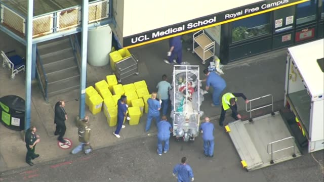 'ebola nurse' pauline cafferkey cleared of dishonesty at hearing lib / 1232015 royal free hospital military nurse corporal anna cross wheeled from... - contracting stock videos & royalty-free footage