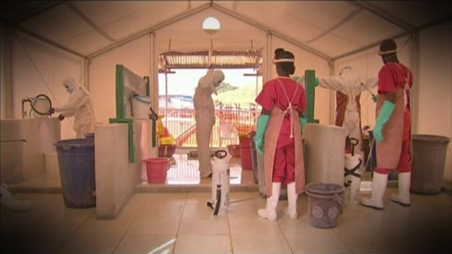 vídeos y material grabado en eventos de stock de ebola nurse pauline cafferkey condition improves t09011534 / 912015 freetown kerry town ebola clinic graphicised pictures health workers in... - ébola