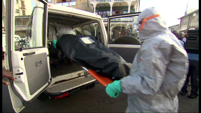 ebola outbreak ebola treatment centres to open within two weeks sierra leone freetown ext justine greening mp out of car and meeting red cross... - stretcher stock videos & royalty-free footage