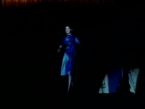 """ebony fashion fair presents, """"what's goin' on"""", a fashion show created by ebony magazine / black woman modeling short, white fur coat / woman... - satin stock videos & royalty-free footage"""