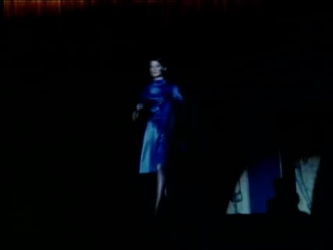 "ebony fashion fair presents, ""what's goin' on"", a fashion show created by ebony magazine / black woman modeling short, white fur coat / woman... - lunghezza video stock e b–roll"