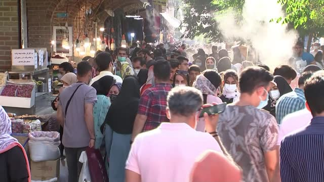 vidéos et rushes de ebrahim raisi widely expected to win presidential election; iran: tehran: ext tehran cityscape cars along with azadi tower behind iran flag flying... - tour d'azadi