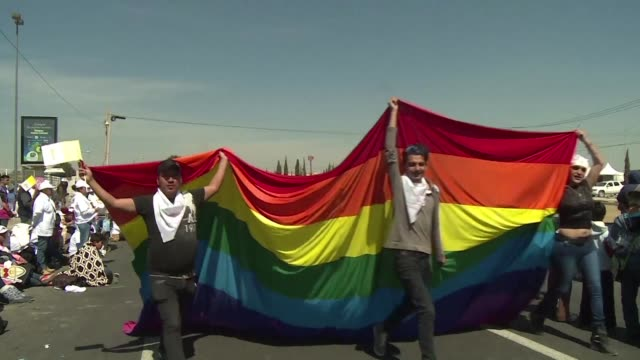 Ecatepec gay activists claimed Sunday a place in heaven and paraded with a rainbow flag as pope Francis gave a giant open air mass
